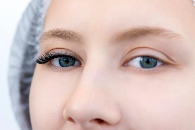 Woman eyelash extensions close up