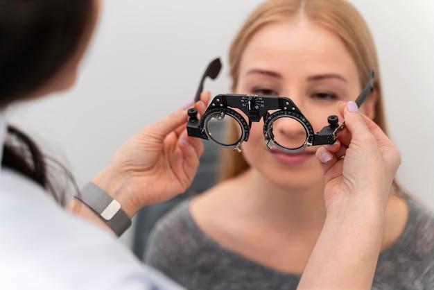 Woman at eyes consult