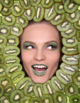 Woman face in fruits healthy nutrition and diet concept.