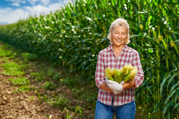 Woman farmer with a crop of corn.