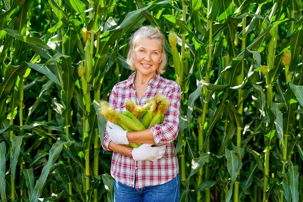 Woman farmer with a harvest of corn.