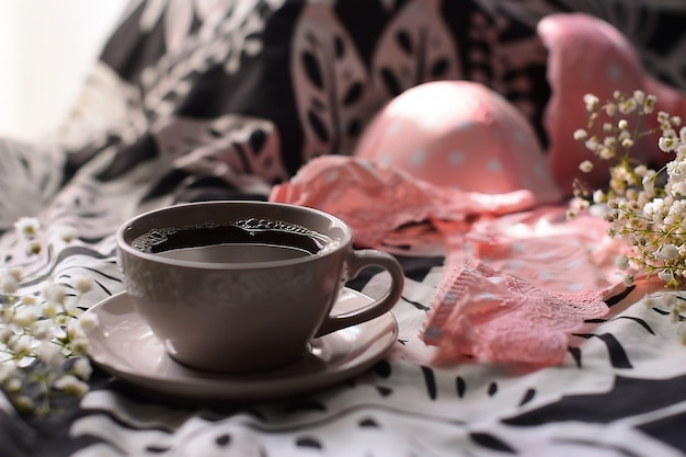 Woman fashion accessories, underwear, bouquet of roses and pions, perfume, jewelry, coffee