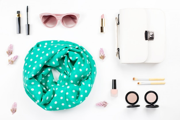 Woman fashion and beauty accessories - purse, sunglasses, scarf, cosmetics. spring concept fashion collection.