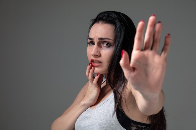 Woman in fear of domestic abuse and violence, concept of female rights