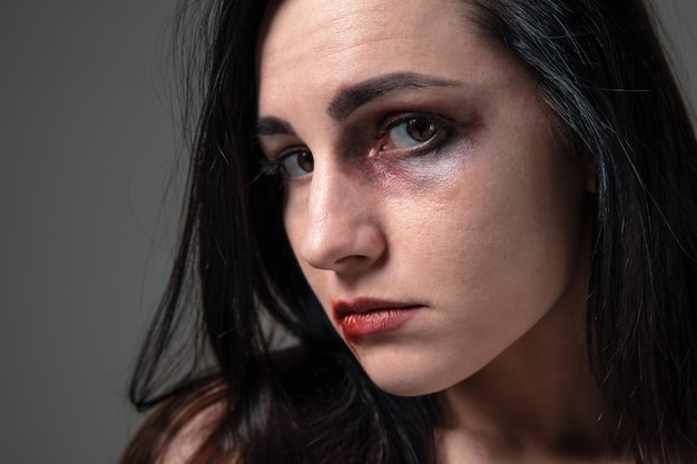 Woman in fear of domestic abuse and violence, concept of female rights.