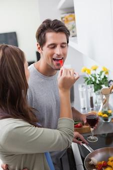 Woman feeding her husband bell pepper