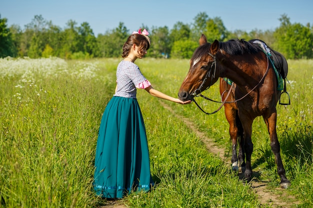 Woman feeds a horse with hands favorite animal