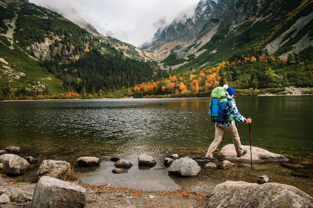 Woman feel freedom and enjoy gold autumn nature in mountain