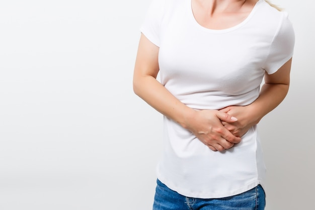 Woman feels strong stomach pain isolated. people, healthcare and medicine concept