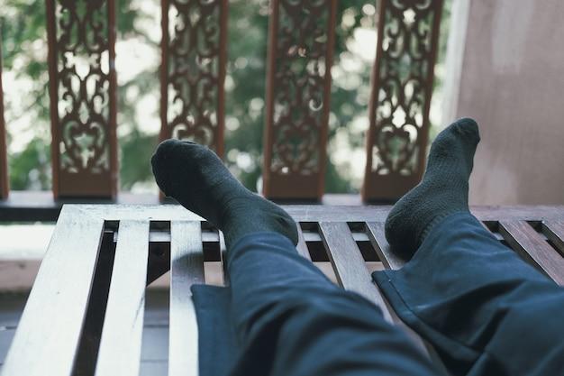 Woman feet resting relaxing on terrace balcony