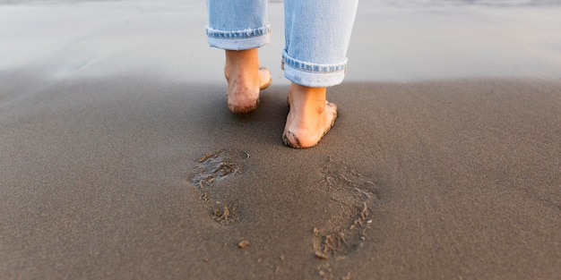 Woman feet on the sand at the beach