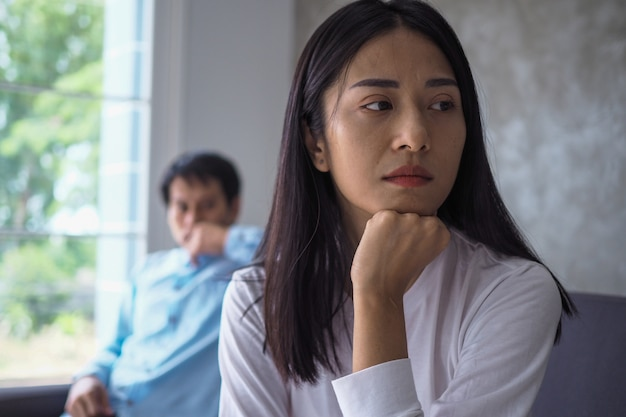 The woman felt depressed, upset and sad after fighting with her husband's bad behavior. unhappy young wife bored with problems after marriage.