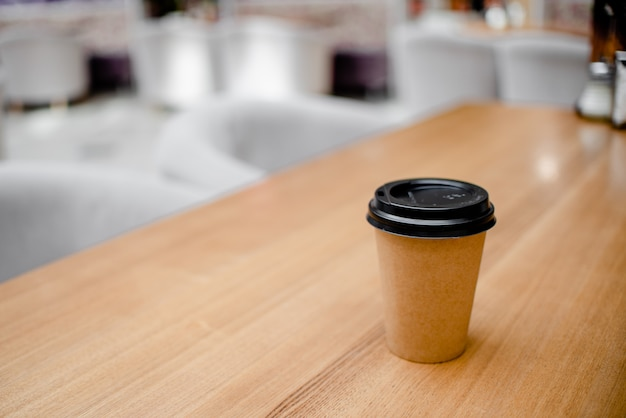 Woman female hand with coffee cup paper latte.
