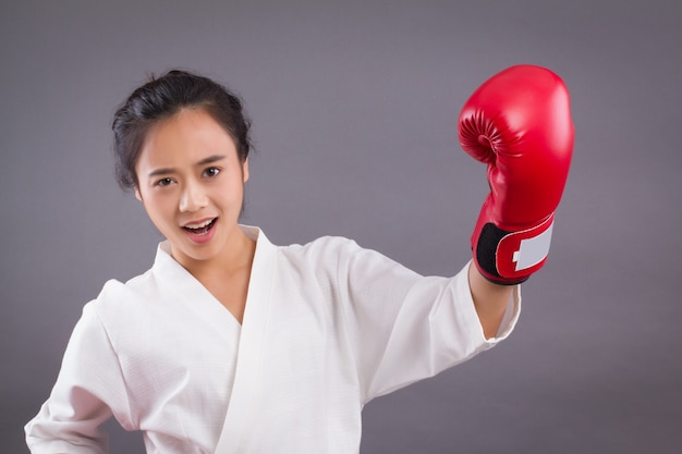 Woman fighter portrait; asian woman practicing martial arts, mixed martial arts
