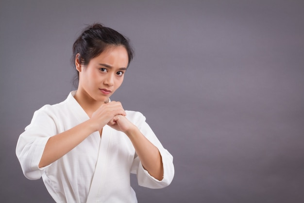Woman fighter portrait; asian woman practicing martial arts, mixed martial arts