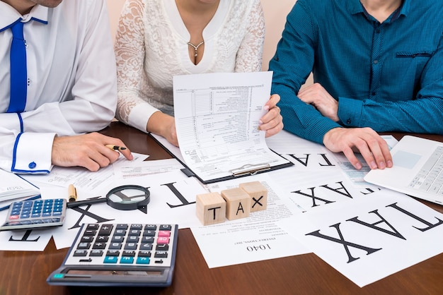 Woman filling 1040 form with advisors help