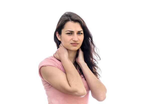 白で隔離の首の痛みを埋める女性