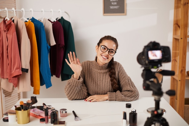 Woman filming beauty and fashion video