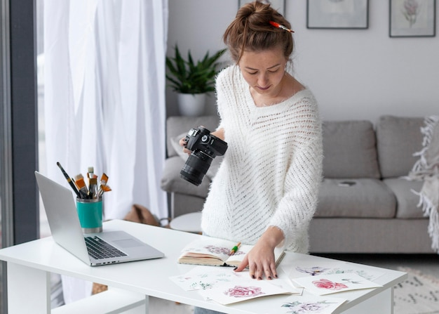 Woman filming her artwork
