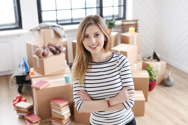 Woman finished with cargo packages and is ready to shipping or moving