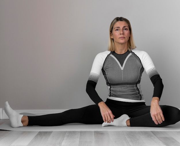 Woman in fitness clothes doing exercises