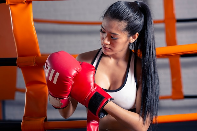 Woman fitness gym of woman taking weight loss for slim and firm athlete builder muscles