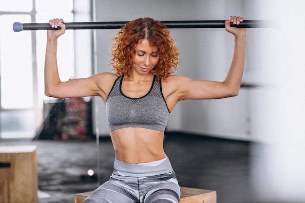 Woman fitness trainer at the gym
