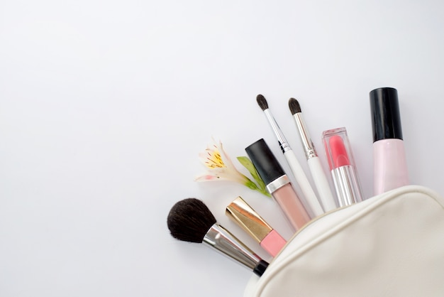 Woman flat lay mak-up background with cosmetics, copy space.