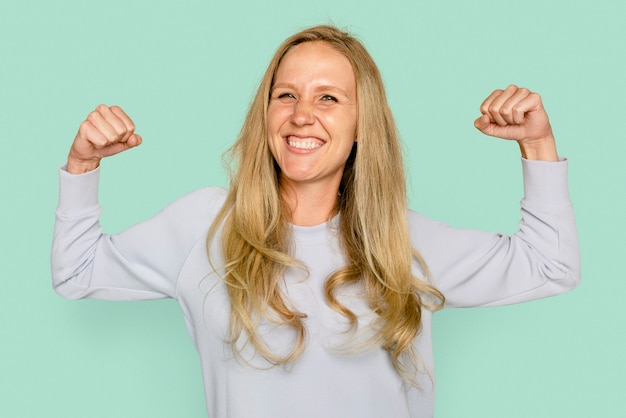 Woman flexing muscles for health and wellness campaign