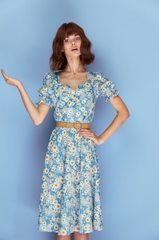 Woman in flower dress surprised facial expression hand gestures summer clothes lifestyle