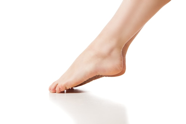 Woman foot on white background, isolated, close-up