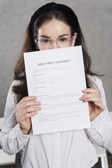 Woman from human resources holding contract