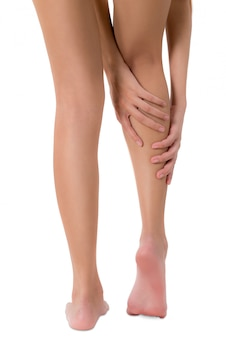 Woman from behind view holding her leg with massaging calf in pain area isolated on white
