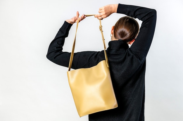 Woman from behind with a brown crossbody bag