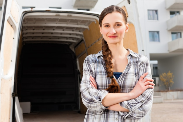 Woman in front of moving truck