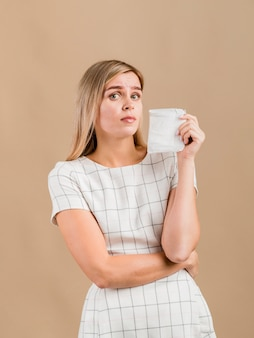 Woman frown and holding a pad