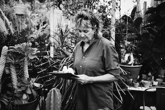 Woman gardening in her greenhouse