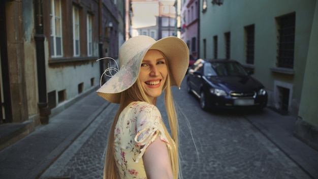 Woman gesturing follow me on street