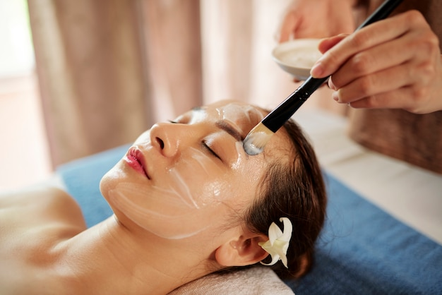 Woman getting anti-aging face treatment
