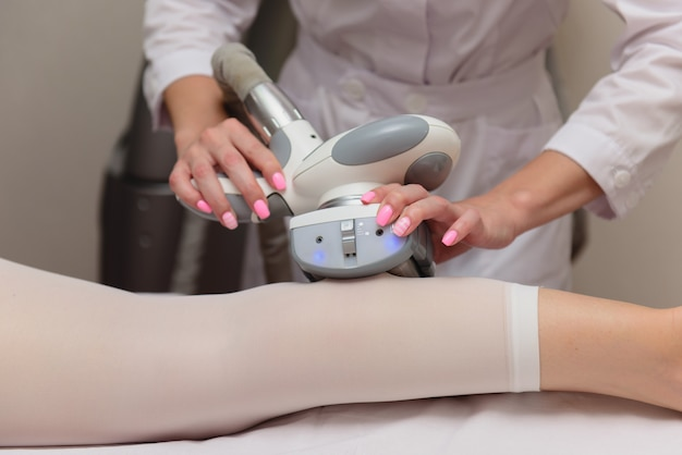 Woman getting anti cellulite body contouring massage  treatment in clinic