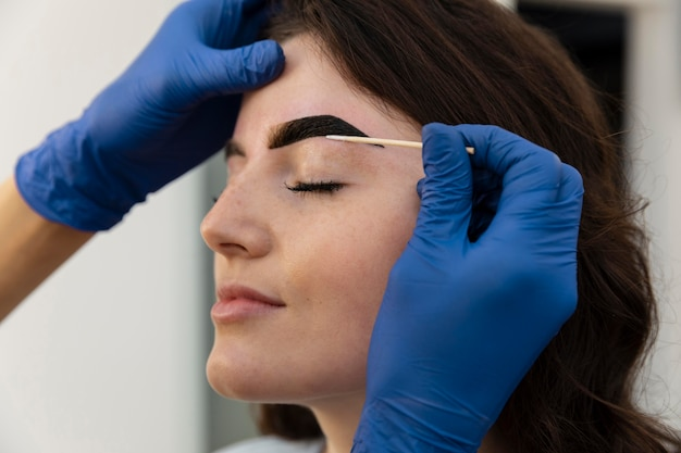 Woman getting an eyebrow treatment at a beauty salon