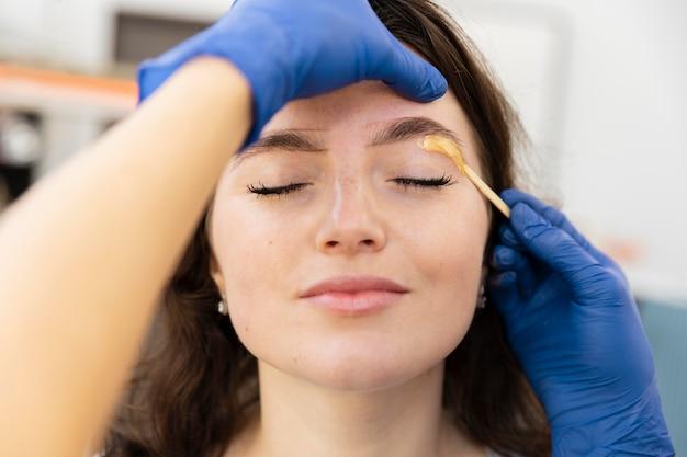 Woman getting an eyebrow treatment