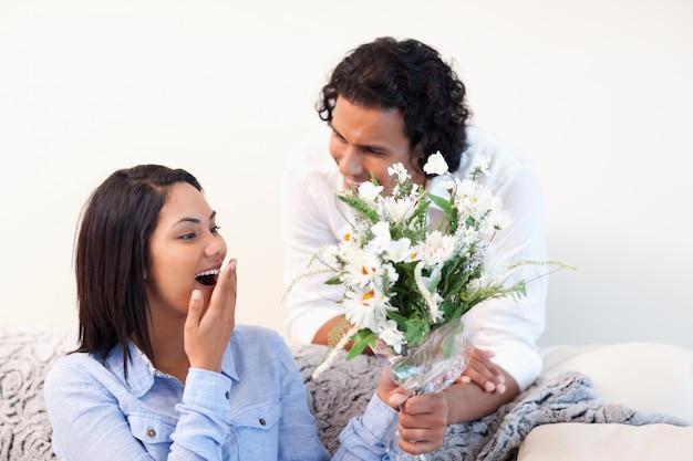 Woman getting flowers from her boyfriend
