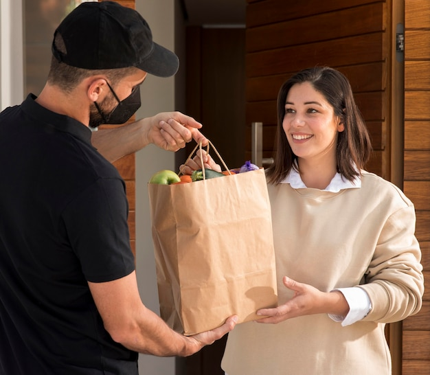 Woman getting a food bag delivered