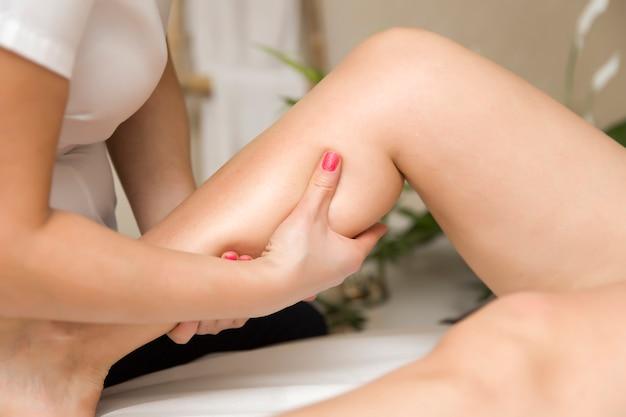 Woman getting leg massage in spa center