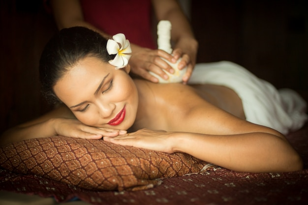 Woman getting a massage from another person