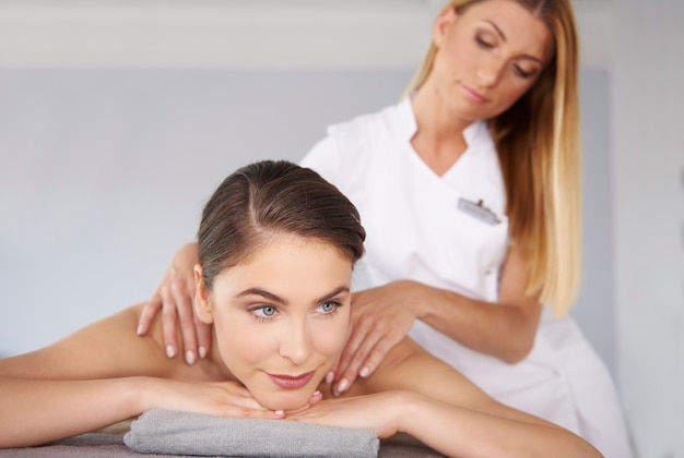 Woman getting massage at spa