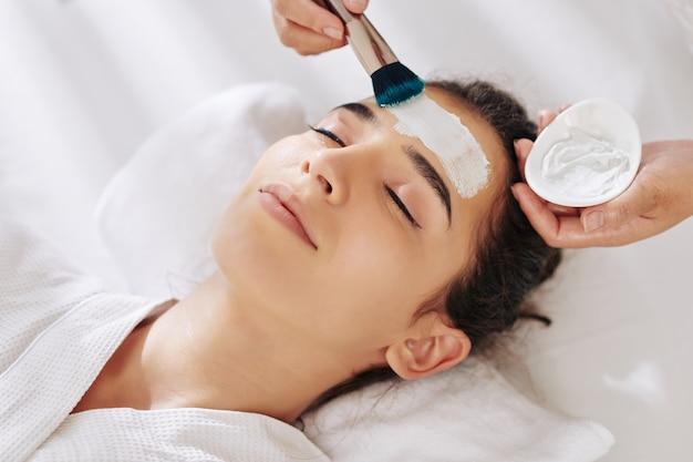 Woman getting moisturizing mask