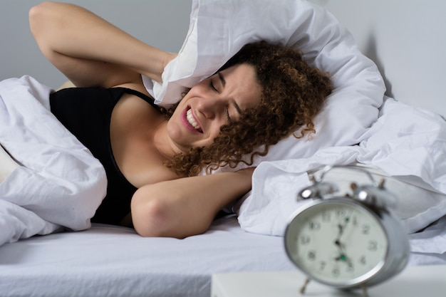 Woman getting stressed about waking up early