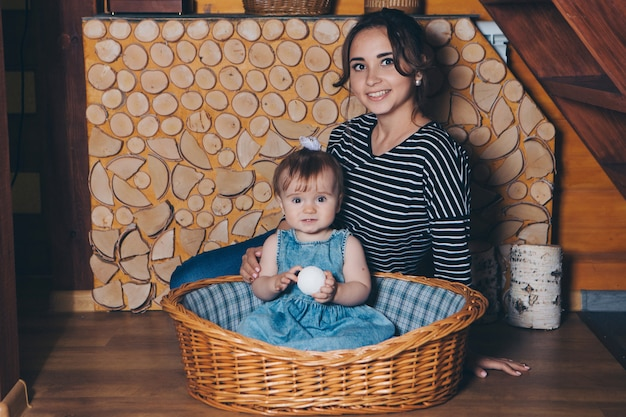 Woman and girl in a dress sitting in a basket